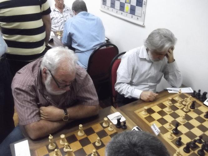 Henrique Mangini e Luiz Alberto da Luz se esforçando em suas partidas